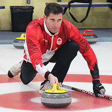 Watch Olympian John Morris ('03) curl for mixed doubles gold